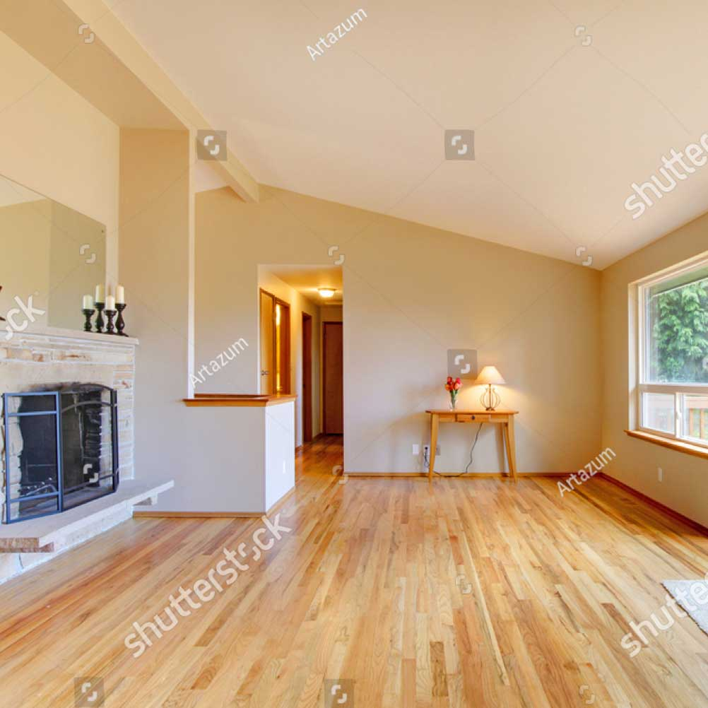 stock-photo-empty-living-room-with-a-fireplace-hardwood-floor-and-sliding-glass-door-exit-to-the-deck-172698587