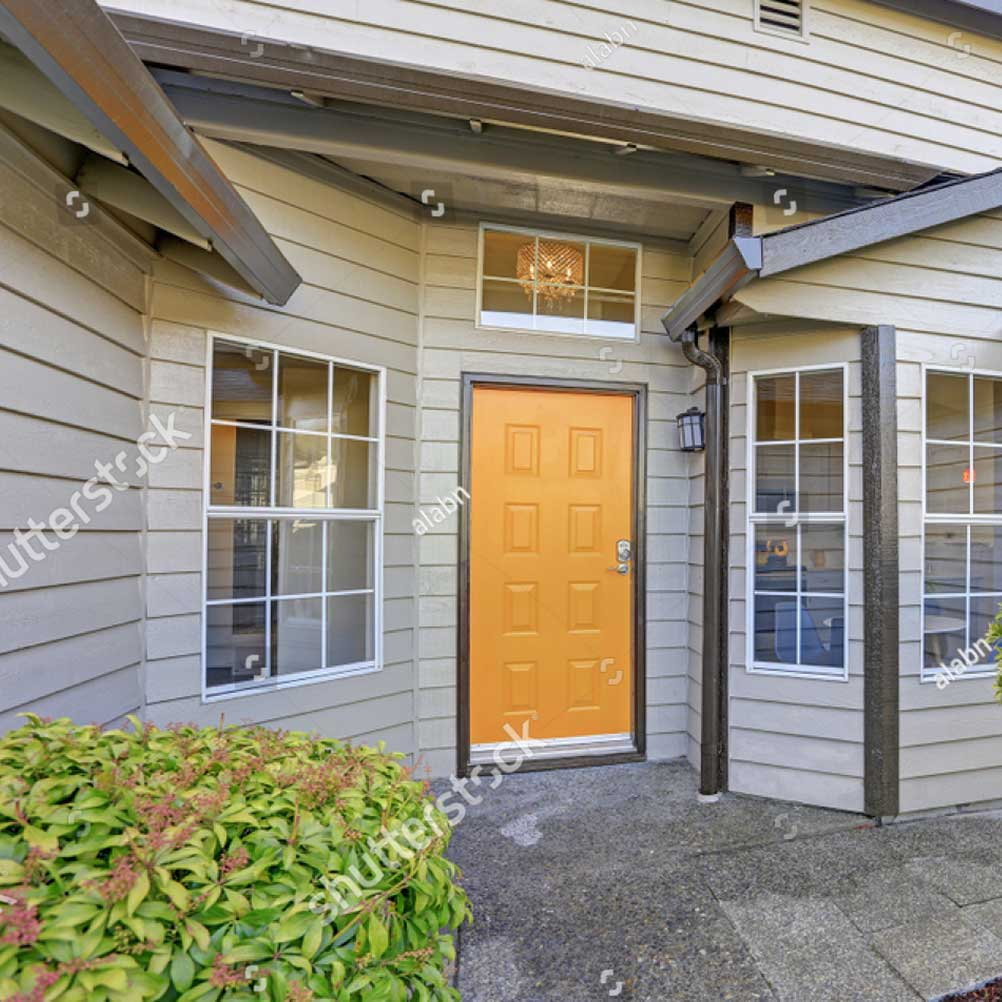 stock-photo-entrance-porch-with-taupe-exterior-paint-yellow-front-door-and-large-windows-790343314