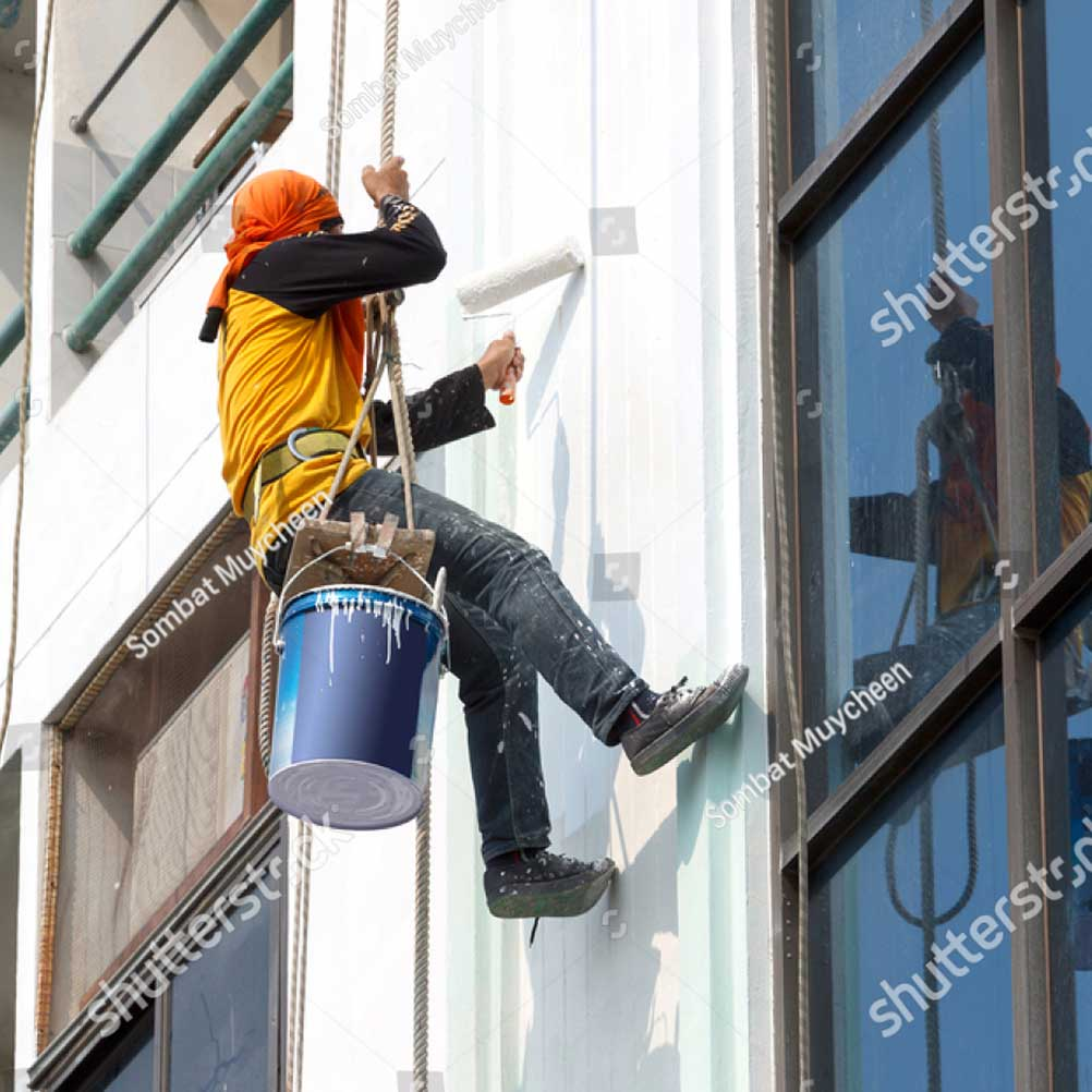 stock-photo-painters-are-painting-buildings-138835316
